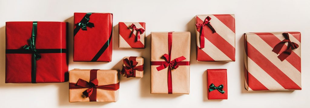 Festive gift boxes in wrapping paper decorated with bows